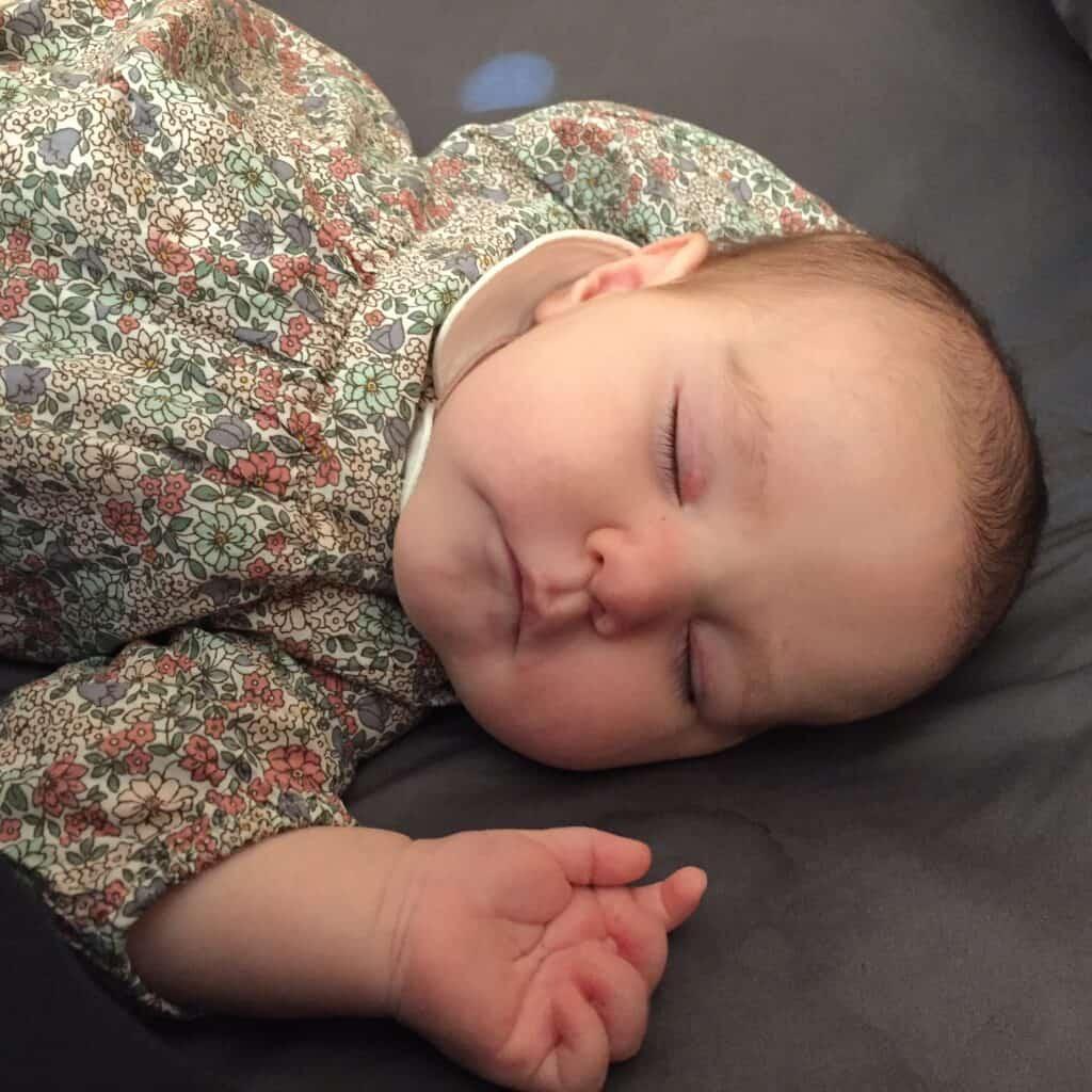 baby girl sleeping on back