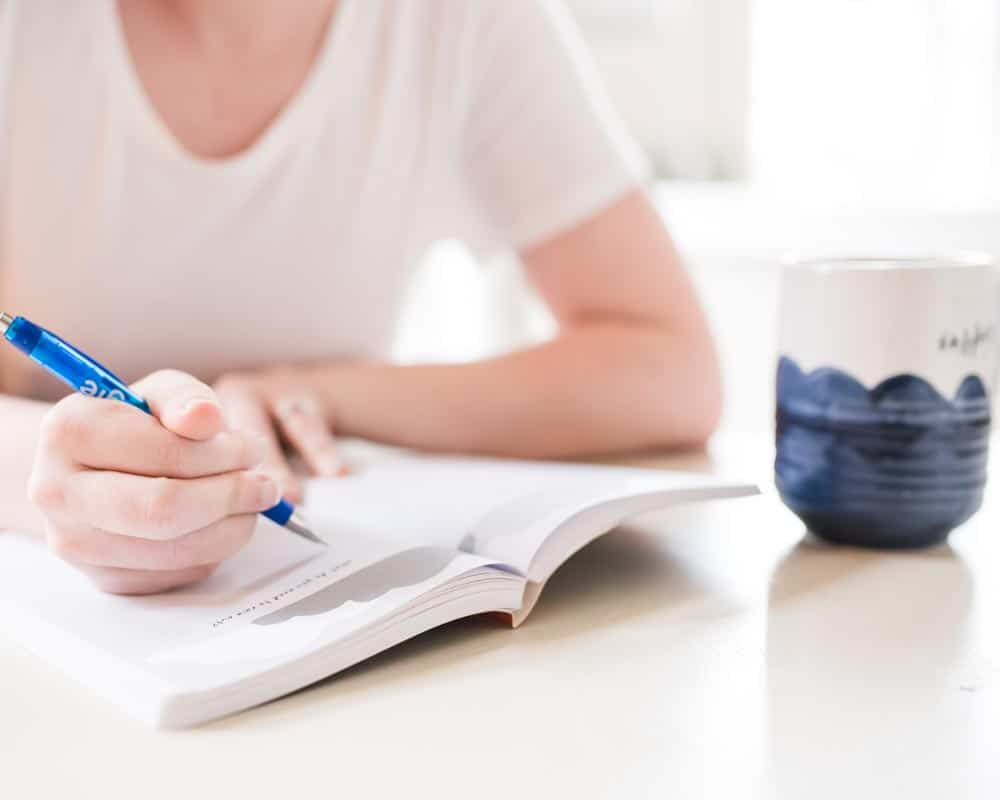hand writing in journal for teens